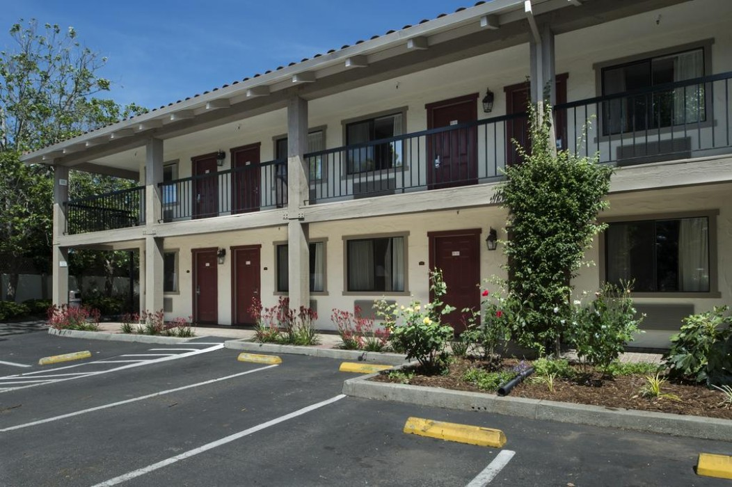 Mission Inn & Suites - Guest Parking with Landscaping