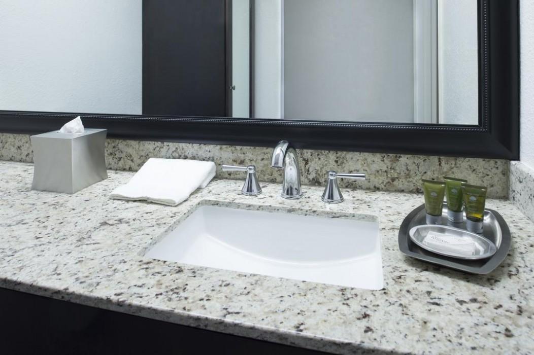 Mission Inn & Suites - Guest Bathroom Vanity